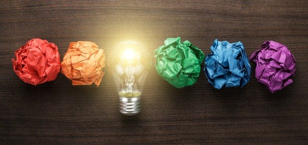 blogging inspiration coloured-balls-of-paper-with-light-bulb-on-wood