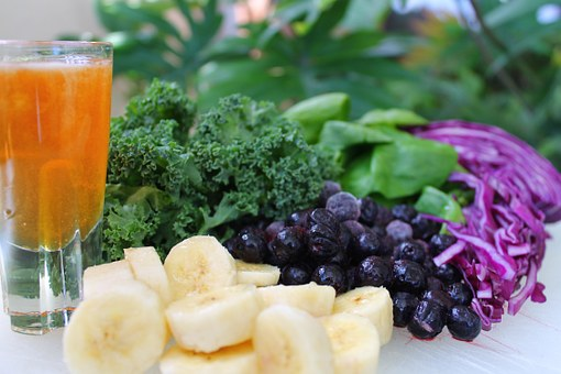 picture-of-broccoli-purple-cabbage-grapes-sliced-banana-smoothie-in-glass