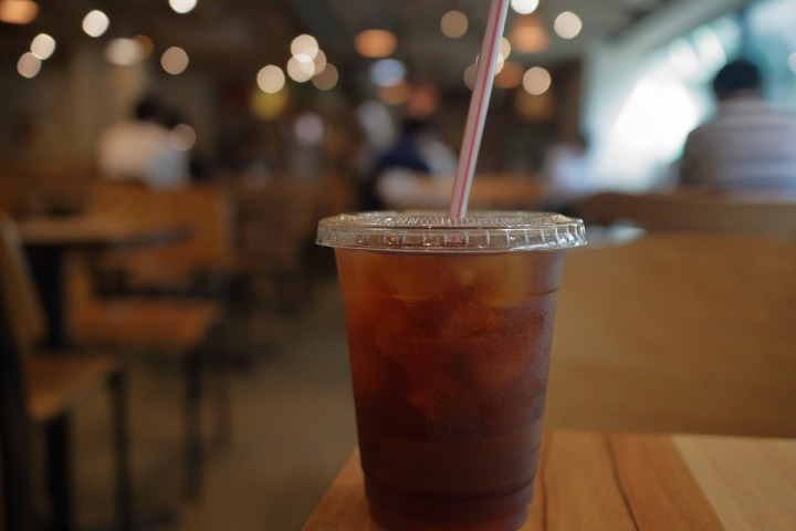 single cold coffee takeaway disposable glass with cover and straw