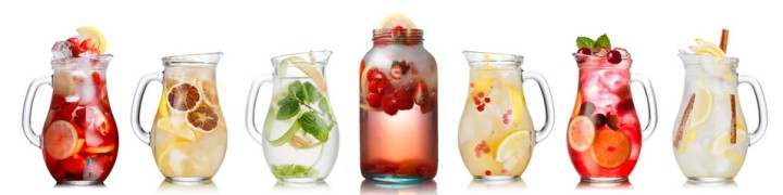 infused water six jugs containing variety of fruit