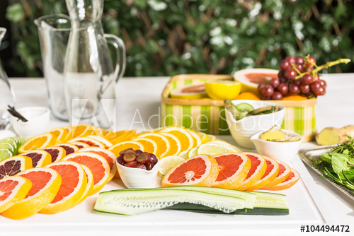 infused water empty pitchers sliced citrus fruit
