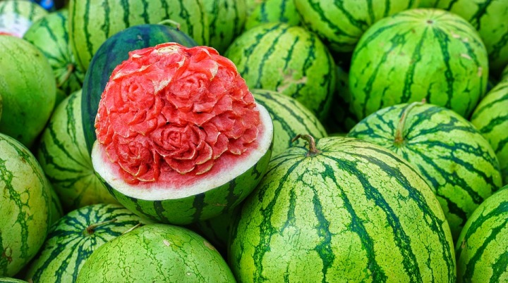 watermelon cut like a rose displayed among many others