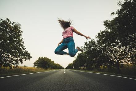 little stress busters woman jumping