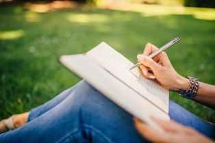 liebster award writing on notebook