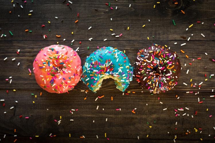 sprinkle sprinkles on donuts