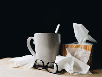 cold remedies white mug glasses tissue box