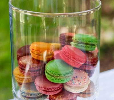 coloured french macaroons glass container
