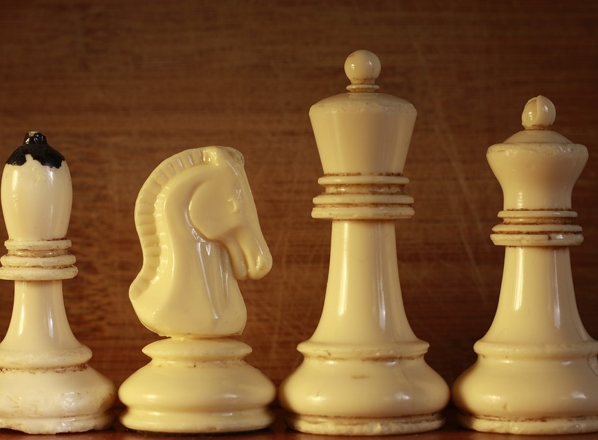 intrigue many faces four chess pieces