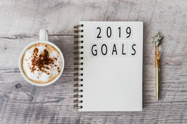 new year's resolutions notepad-with-2019-goals-inscription-on-table_23-2147983884