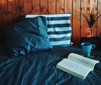 winter weekend open book beside blue mug