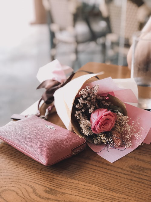 pink bouquet and wallet