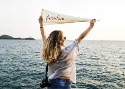 leisure woman with freedom banner