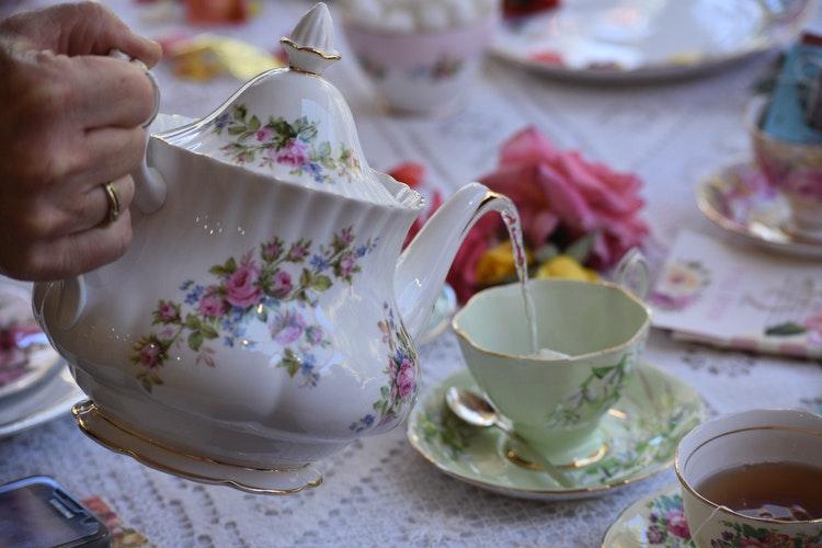 teapot floral pouring tea into cup