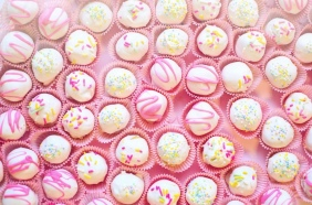 pink candy in paper cases