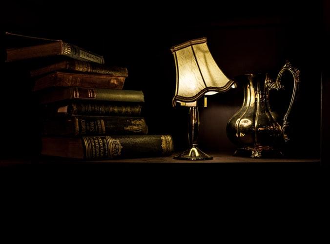antique books lamp pitcher
