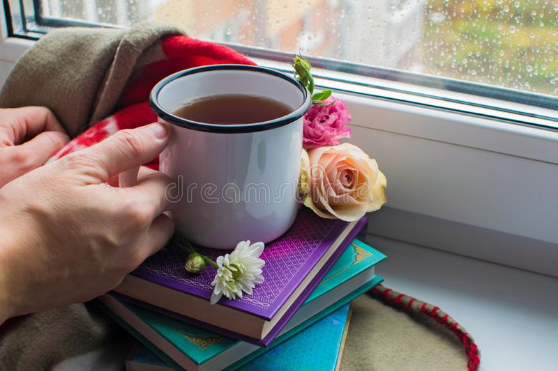 rain tea books flowers