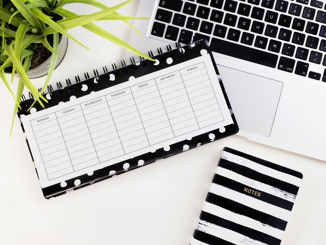schedule white printed paper laptop
