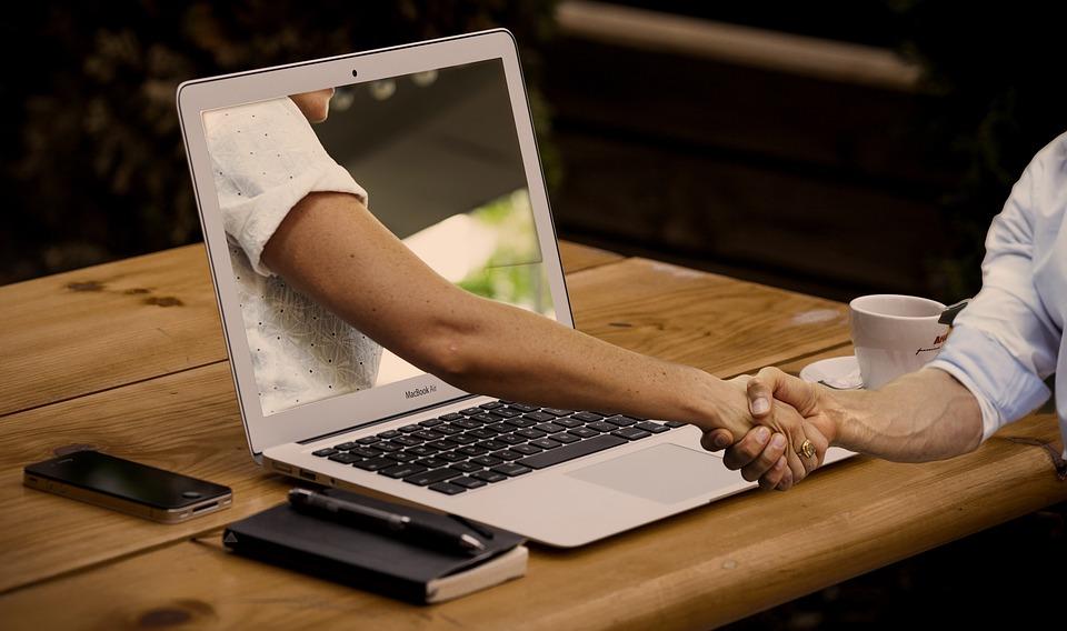 Handshake hands laptop