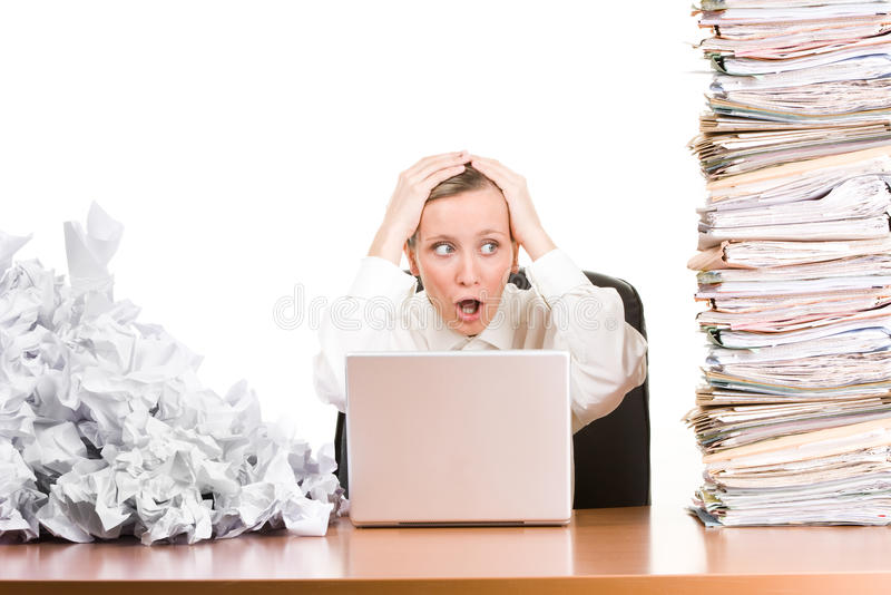 crumpled drafts woman laptop paper stack