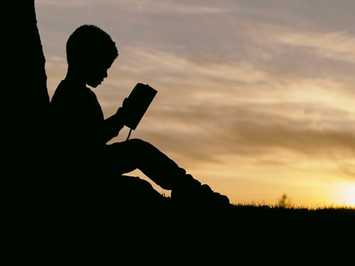child reading silhouette