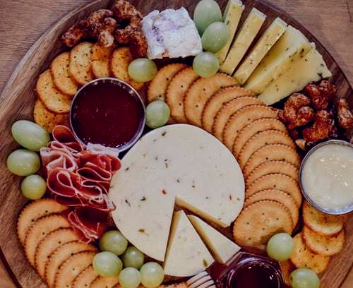 cheese board fruit crackers