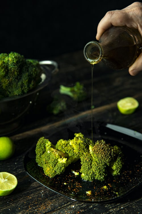 broccoli pouring oil
